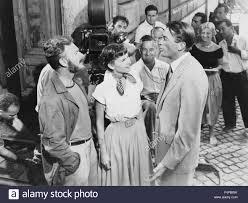 Eddie Albert, Audrey Hepburn, Gregory Peck / Vacanze Romane 1953 diretto da  William Wyler Foto stock - Alamy