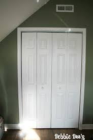 white wood door. Plain White Builder Grade Closet Doors Makeover To Look Like Wood Door