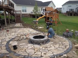 flagstone patio with fire pit. Construction Of Canadian Flagstone Patio With Brick Paver Accent And Unilock Fire Pit. All Pit W