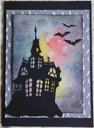 assemble the card and cut the haunted house and bats using your favorite cut machine bat and haunted house