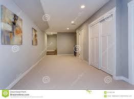 Light Grey Walls Beige Carpet Wide Hallway Of Home Basement Stock Photo Image Of Clean