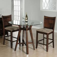 glass and wood bar height table with cream velvet cushioned seat chairs lovable tall bistro