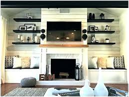 bookshelf around window built ins around window built ins around fireplace built in cabinets around fireplace