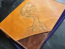 picture of leather book cover with pyrography time lapse video