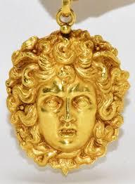 pendant in 22 kt yellow gold medusa head floine craftsmanship