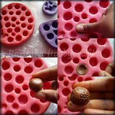 i will show bird design silicon mould and it has 2 studs and pendant design place a little amount of clay and press then remove the excess and remove the