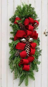 front door hangingsHow to Make a Christmas Swag  FYNES DESIGNS  FYNES DESIGNS