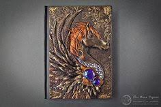 aniko kolesnikova creates darling journal covers molded out of clay and rich in dreamy detail better known as mandarin duck this creative lady ke