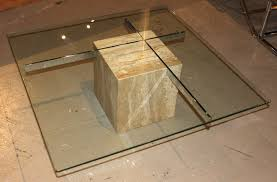glass top coffee table with marble base as oak living room furniture to redesign your elegant interior
