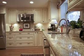 Santa Cecilia Light Granite Countertops Modern White Kitchen Cabinets  Stainless Steel Appliances