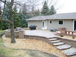 raised patio with paver stair system by oasis landscapes in west fargo raised patio with retaining seating wall