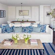 white slipcovered sofa with blue pillows