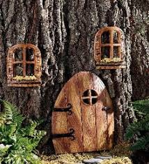 Image result for little doors on trees