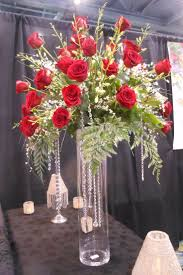 red rose arrangement on a tall glass vase with hanging crystals. http://