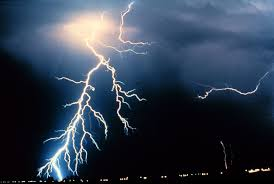 lighting from the ground. lightning follows a jagged path to get from cloud the ground lighting