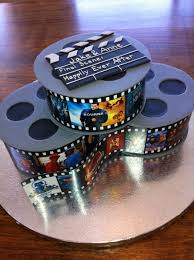 Jake's Cake - Film reels for a real-movie buff. Gumpaste disks sandwich a  single layer of fondant covered cake. The … | Movie cakes, Movie theme cake,  Grooms cake