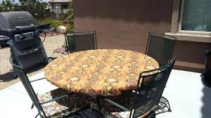 round fitted tablecloth in cinnabar outdoor fabric elastic drawstring stain resistant vinyl tablecloths