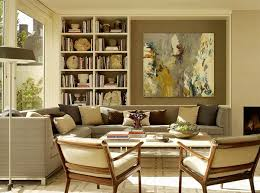 beige furniture. living room with light brown walls and beige furniture