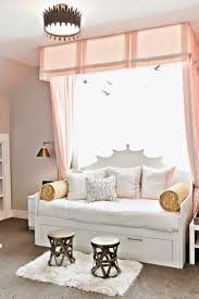 ikea brimnes bed with custom headboard turns into daybed. could do  upholstered headboard too LOVE the curtain above the bed.