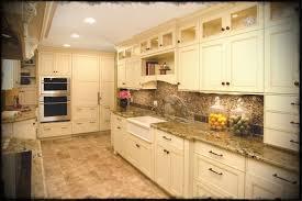 elegant cabinets lighting kitchen. Elegant Cream Kitchen Cabinets With Under Cabinet Lighting And Mosaic Tile Backsplash Plus Quartz Granite Countertop
