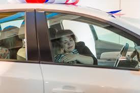 recipient hugging her children in new vehicle
