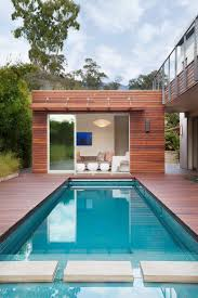 Outdoors:Minimalist Pool House With Cozy Sofa Near Modern Pool With Wood  Pool Deck Backyard