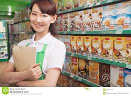 female s clerk working at supermarket stock photo image female s clerk working in a supermarket stock images