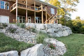 natural stone retaining wall by lambs lawn service