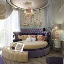View in gallery Round bed with purple hues brings in a regal flavor