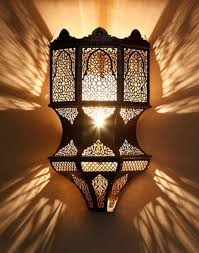 moroccan style lighting can add a signature ornate moroccan wall sconce installed in the wall