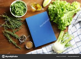 Notebook And Vegetables On Kitchen Table Cooking Classes Concept