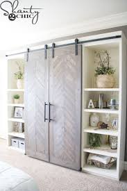 cool bookcase wall with sliding barn doors
