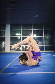 floor gymnastics moves. Girl Doing Rhythmic Gymnastics Floor Moves