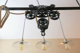 1904 10 vintage industrial myers o k ornamental cast iron unloader farm hay trolley pulley this custom pendant light is made by suspending three glass