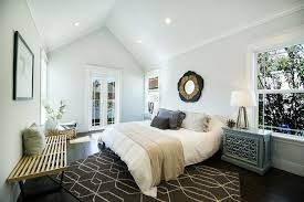 5 tags Contemporary Master Bedroom with Crown molding, Hardwood floors,  Carpet, Cathedral ceiling