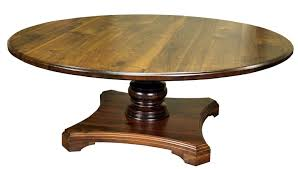 custom round walnut table with turned pedestal style base