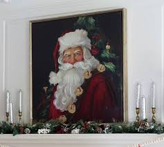 talk about me being drawn to something when i saw this huge santa on canvas at hobby lobby i had to have it i do not purchase new décor every year and