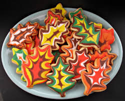 decorated thanksgiving sugar cookies iced like fall leaves on a platter
