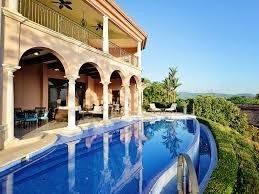 infinity pool house. The House Overlooks Marina And Resort. Here You Find Luxury Surrounded By Jungle Infinity Pool