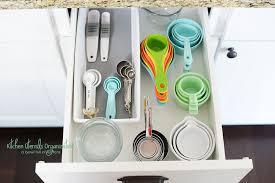 organizing the kitchen utensils a bowl full of lemons