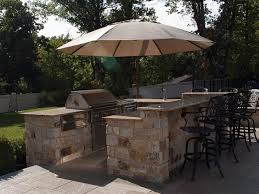 outdoor kitchen and patio construction by sage landscape contractors backyard