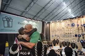 big dave sylvester right embraces a vendor at las vegas gift