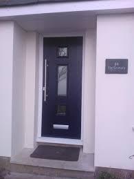 simple black posite front door design with large door handle