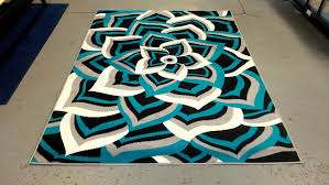 image of orange and turquoise area rug