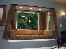Living Room:Futuristic Bay Window Design With Brown Curtain And Floral  Bench Seat Decor Idea