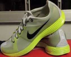 nike running shoes flywire. the nike lunaracer+ shoes contain flywire. vectran fibers are visible as thin lines behind and around logo. running flywire
