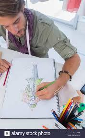 Fashion Designer Drawing A Coat Stock Photo 69853973 Alamy