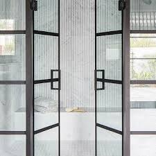 glass and steel bi fold shower doors