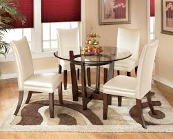 signature design by ashley charrell 5 piece round dining table set with ivory chairs ahfa dining 5 piece set dealer locator