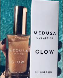 indulge in the ultimate in moisturizing shimmering body oils with glow by medusa cosmetics this